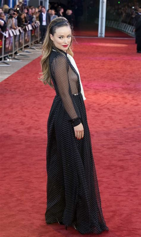 Olivia Wilde in a dress without bra on the red carpet