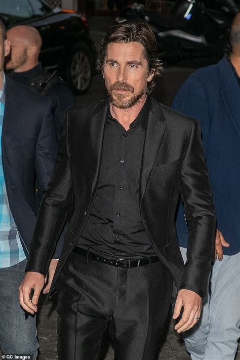 Christian Bale looks suave as he takes his family to the